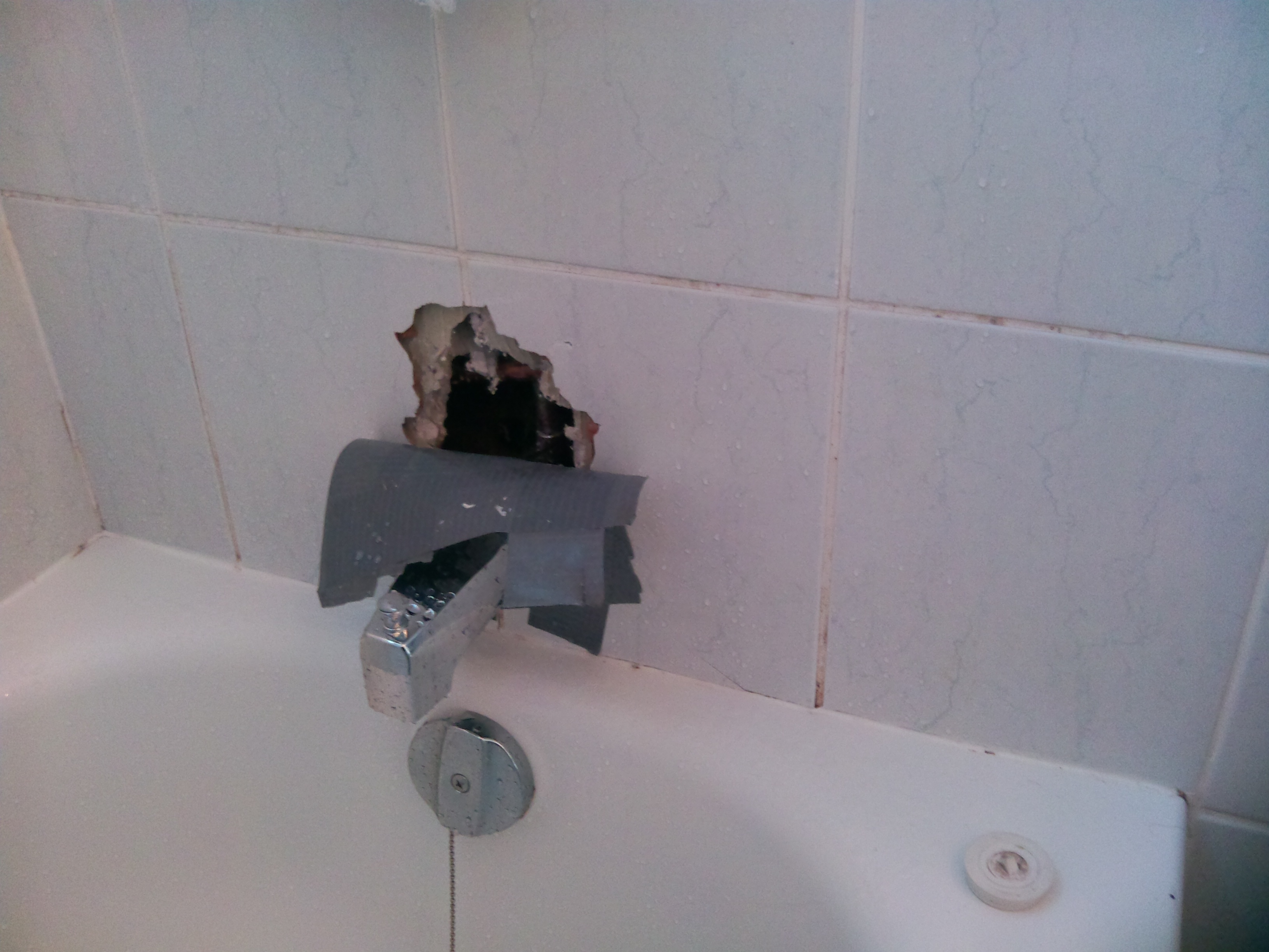 before bath tub tile repair